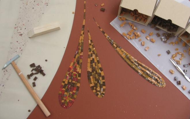 Intarsi a mosaico su pannello in resina cementizia