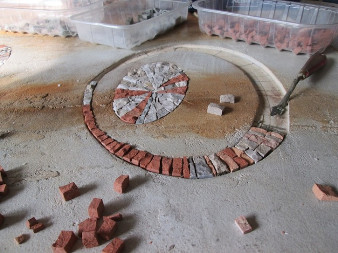 Nicchie ad anello in cui inserire direttamente le tessere